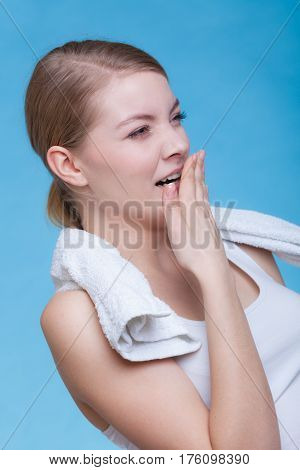 Bored Sleepy Woman Yawning While Holding Towel