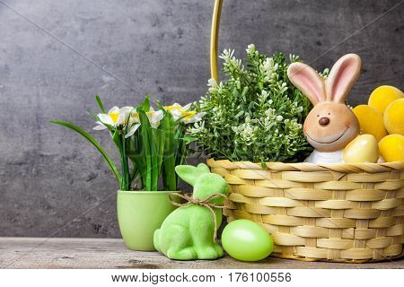 Easter Holiday Basket With A Bunny, Eggs And Flowers