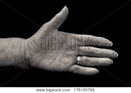 Mature Woman's Hand In Greeting Gesture. Black And White.