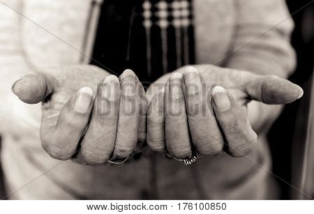 Elderly Lady's Hands In Begging Gesture. Black And White.