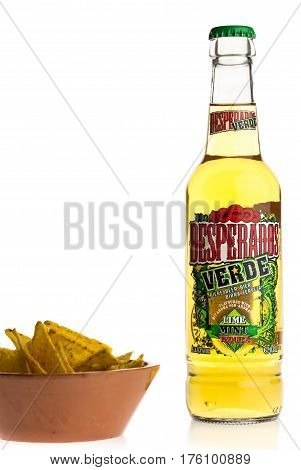 GRONINGEN, NETHERLANDS - MARCH 04, 2017: Bottle of Mexican Desperados Verde beer with nachos isolated on a white background