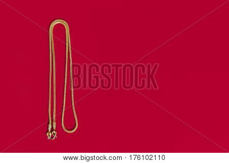 Gold Necklace 96.5 Percent Thai Gold Grade With Gold Hook Isolated On Red Background