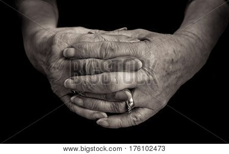 Black And White Close Up Of Female Pensioners Hands.