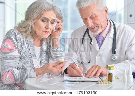 Portrait of a sick elderly woman in a doctor's office