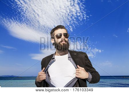 Young Hipster Superhero In Vacation In Front An Island At Sea