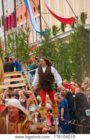 Landshut,Germany-June 30,2013: A man walks on stilts during the Landshuter Hochzeit medieval pageant