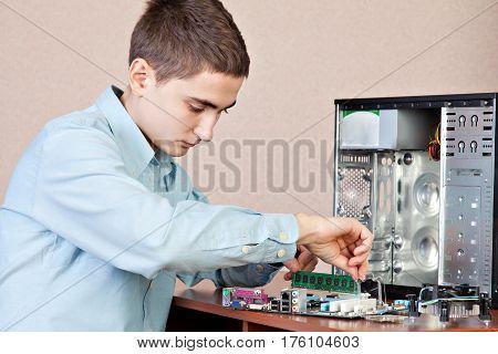 Technician repairing computer hardware in the lab. Studio shot. Small DOF