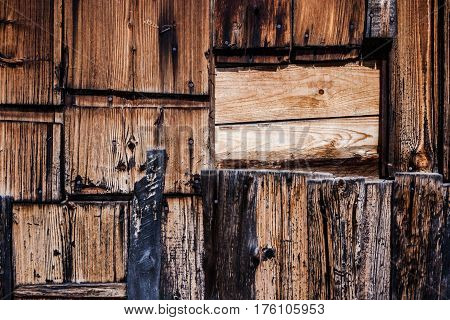 Wooden background. Wall from randomly attached old destroyed by time wooden planks.