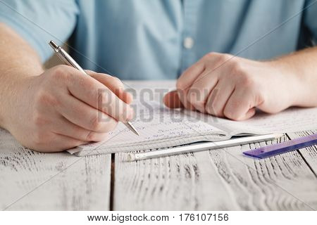 Close Up Male's Hand Writing On Paper, Writing Messy Math, Student Holding Pen Doing Homework At Hom