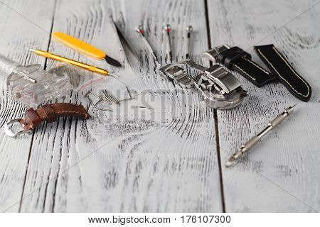 Watchmaker Tools On Wood Texture And Free Space For Text Edit