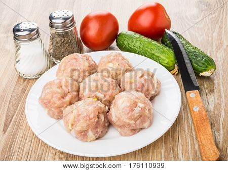 Raw Meatballs In Plate, Salt, Peeper, Vegetables And Knife