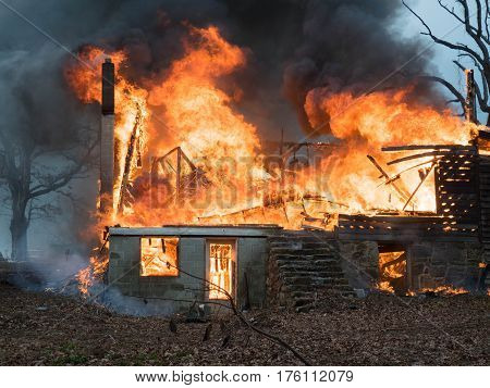 house completely engulfed in fire and destroyed