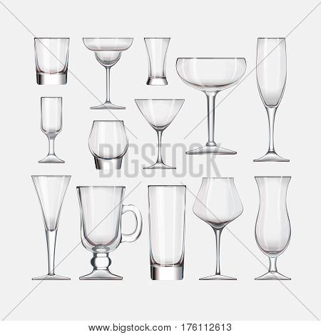 set of empty cocktail stemware and glasses for alcohol