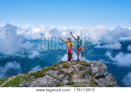 Proud And Happy Travelers On Top Of The Mountain