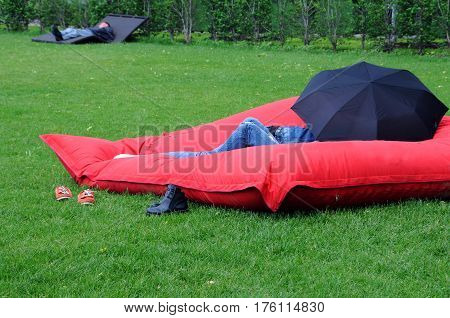 MOSCOW RUSSIA - MAY 31 2015: People relax on the lawn in Gorky park