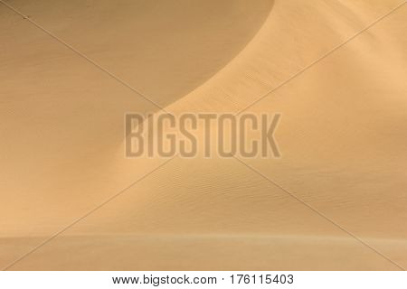 Big wandering sand dune in desert or beach. Sand dune texture in african desert. Background.
