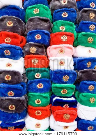 Soviet symbols. Multicolored caps with Soviet cockades are sold in the center of Moscow for tourists.