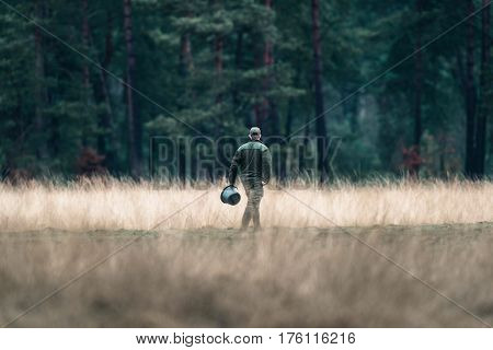 Rangers With Feeding Bucket In Field. National Park Hoge Veluwe.