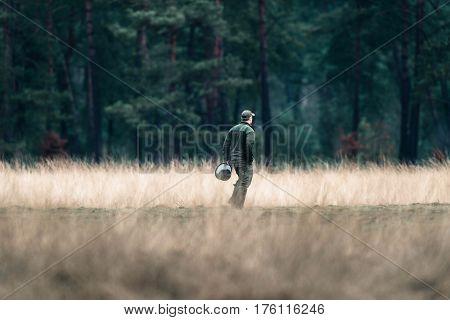 Rangers With Feeding Bucket In Field. National Park Hoge Veluwe.