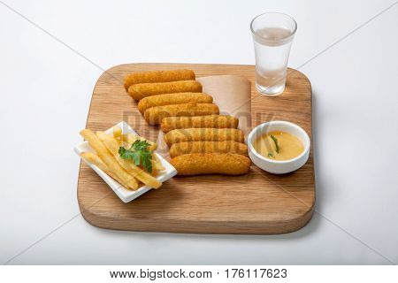 Fish Sticks On A Wooden Board.