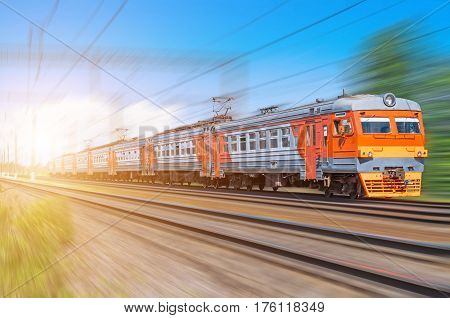 Passenger electric train long rides speed railway wagons journey light.