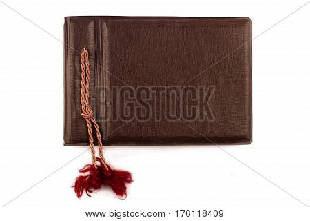 top view of vintage photo brown album cover with rope bindings isolated on white background