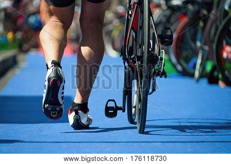 Running triathlete in the transition zone,triathlon bike the transition zone
