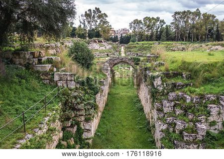 Ancient ruins of Roman Amphitheater in Archaeological Park in Syracuse Sicily Italy