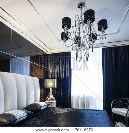 Dark bedroom Golden lamp blue silk velvet laconic interior