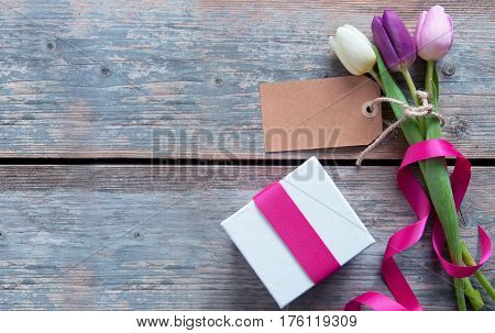 Gift flowers with blank label and decorative ribbon