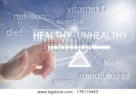 Finger pressing a touchscreen interface with a seesaw icon balancing healthy and unhealthy choice