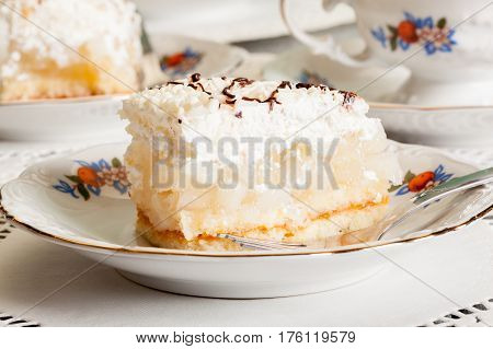 Fresh Sweet Apple Cake With Whipped Cream Served With Cup Of Tea
