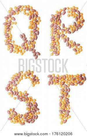 The letter QRST alphabet made of medical pills