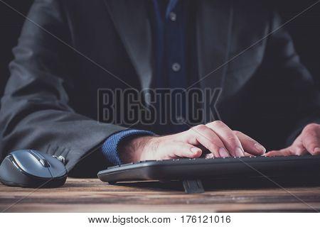 Male Hands Writing On Computer Keyboard Dark Background
