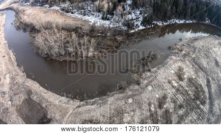 Bend of the Sot river. Early spring. There is no green grass yet. One can see the remnants of snow. Yaroslavl region. Russia