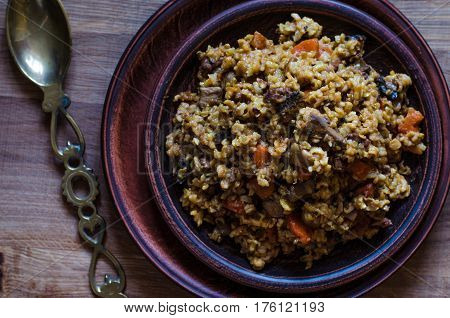 Vegetarian Pilaf With Carrots Mushrooms And Walnuts
