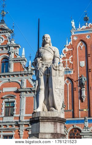 Roland monument and famous landmark building called House of Blackheads on background Old City of Riga Latvia