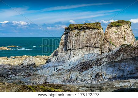 Rocky shore of the Bay of Lee on the north coast of Devon. A clear day the sun is shining. Summer. England