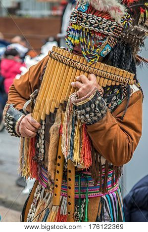 MILAN ITALY - DECEMBER 11 2016: South American Indian buskers play traditional panpipes music at Duomo di Milano market.