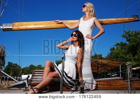 Stylish wealthy women on a luxury yacht.