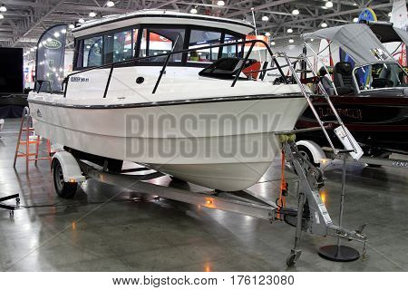 MOSCOW - MARCH 09 2017: Boat Alaskan Ranger 580 HT for 10 International boat show in Moscow. Russia.
