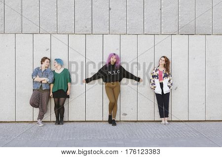 group of young adolescence girlfriends isolated on a gray wall