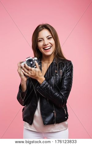 Girl in casual outfit hold old camera ready to take pictures and have some fun