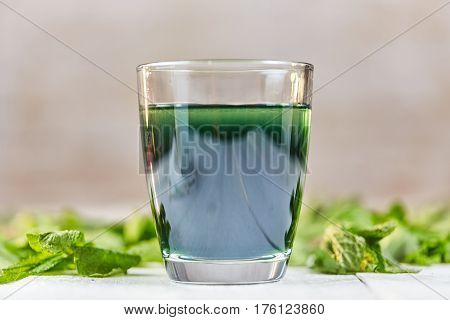 Green Chlorophyll Drink In Glass With Water