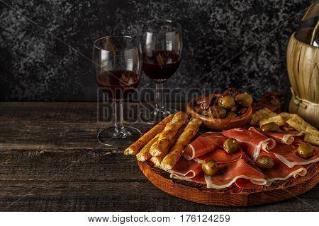 Prosciutto, Cracker, Bread Sticks With Red Wine.