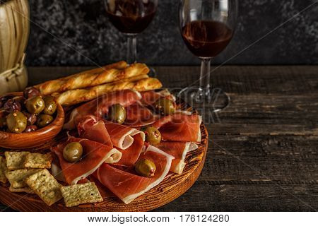 Prosciutto, Cracker, Bread Sticks With Red Wine.