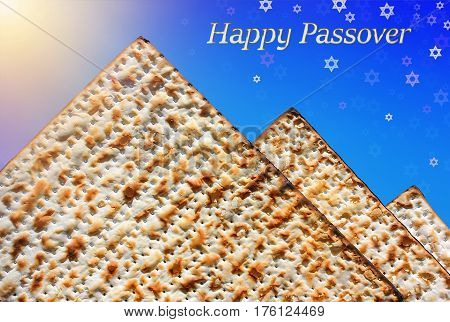 jewish holiday of Passover, stylized pyramid of matzo on the blue background with Stars of David and inscription - Happy Passover