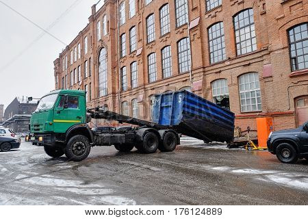 truck loads of large container with debris