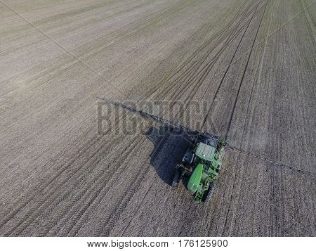 Tractor With Hinged System Of Spraying Pesticides. Fertilizing With A Tractor, In The Form Of An Aer