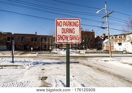 sign no parking after the snow storm